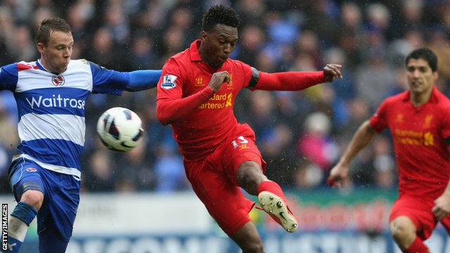 Liverpool forward Daniel Sturridge (c) in action against Reading