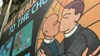 A cartoon poster of two male ministers kissing