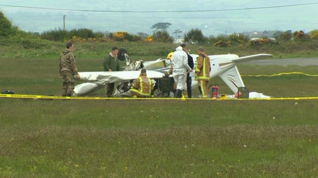 Air accident investigators at the crash scene