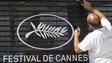 Workman preparing Cannes Film Festival sign