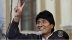 Evo Morales doing the victory sign