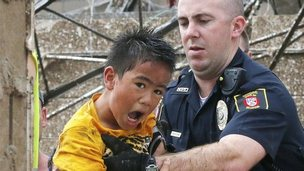 A boy is pulled from the wreckage of Plaza Towers Elementary School in Moore. Photo: 20 May 2013
