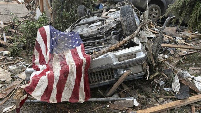 Overturned car and American flag