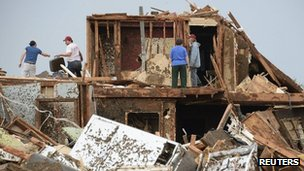 People look for belongings after a tornado struck Moore, Oklahoma