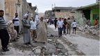 Iraqis inspect bomb damage in Tuz Khurmato (21/05/13)