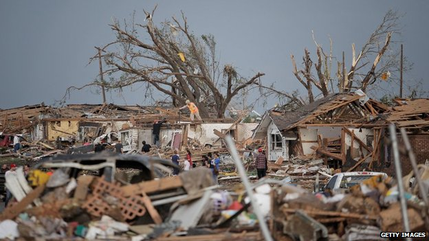 People assess the damage to their homes