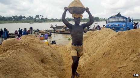 A man walks to off load sand in a truck at Yenagoa sand market in Bayelsa State, Nigeria (archive shot)
