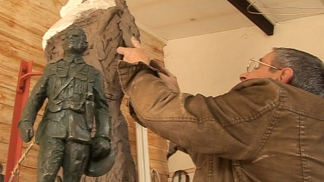 Artist John Doubleday at work on the statue