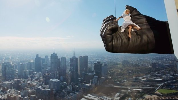 Stunt expert Leigh-Anne Vizer sits on King Kong's hand