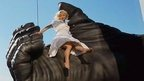 Stunt expert Leigh-Anne Vizer sits on King Kong&#039;s hand