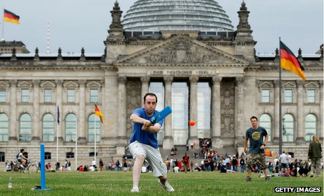 British tourist Phil Lightbody plays cricket with friends in front of the Reichstag in 2010