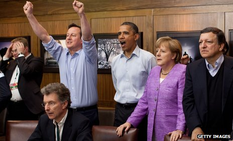 At a gathering of G8 leaders, including German Chancellor Angela Merkel, UK prime minister David Cameron celebrates as Chelsea score against Bayern Munich during the 2012 Champions League final