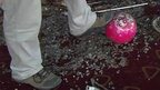 Foot on bowling ball amid debris and glass in Moore, Oklahoma