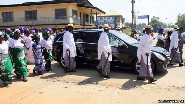 Car taking deceased for burial at an Igbo funeral in Nigeria