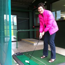 Sally Swinfen trying out golf