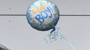 Baby boy balloon carried by Rooneys