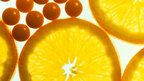 vitamin C tablets and orange slices