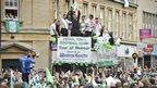 Yeovil Town football team celebrate in Yeovil town centre as the recently promoted football team take part in a Tour of Honour aboard an open top bus through Silver Street in the Somerset town.