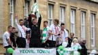 Yeovil Town players on board an open-top tour bus as they are seen during a celebration parade around the Somerset town on May 21, 2013 in Yeovil, England.