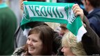 Fans greet the Yeovil Town FC open-top tour bus as its does a celebration parade around the Somerset town on May 21, 2013 in Yeovil, England.