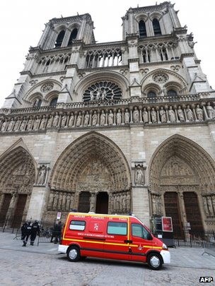 Police and a fire brigade vehicle stand outside Notre dame Cathedral in Paris, 21 May