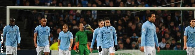 Manchester City players show their disappointment after conceding a goal
