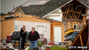 Residents look at destroyed property