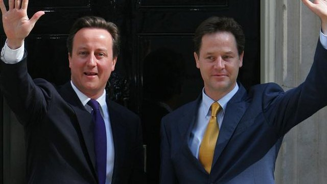Prime Minister David Cameron (L) and Deputy Prime Minister Nick Clegg, wave as they pose for pictures outside 10 Downing Street in London, on May 12, 2010