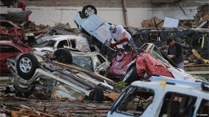 Overturned cars in Oklahoma following the huge tornado that struck on Monday, 21 May 2013