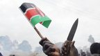 A Kenyan flag and knife held aloft after elections in December 2007