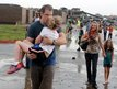 Teachers carry children away from Briarwood Elementary school in south Oklahoma City