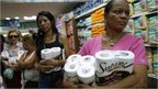 Women queuing to pay for toilet paper at a supermarket in Caracas