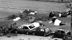 Dead horses covered up and wrecked cars at the scene of carnage in Rotten Row, Hyde Park, after an IRA bomb exploded as the Household Cavalry was passing
