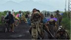Congolese people carrying their children and belongings as they flee conflict (November 2013)
