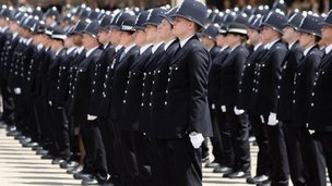 Newly qualified Metropolitan police officers take part in their passing out parade at Hendon Police Training College on June 29, 2012