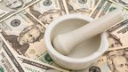 Pestle and mortar on dollar bills