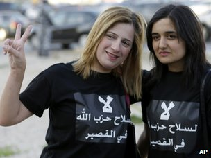 "Women wear T-shirts saying ""No to Hezbollah weapons in Qusair"" at a protest in Beirut, Lebanon (21 May 2013)"
