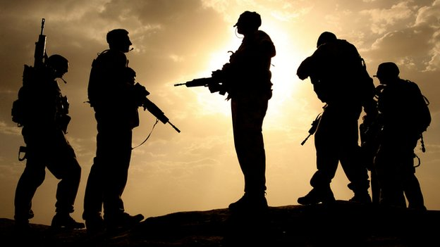 British soldiers from 21 Air Assault Battery Royal Artillery, are silhouetted against the sky at the fortress Qala-e-Bost in Lashkar Gah, Helmand province