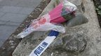 Flowers lie near a crime scene where one man was killed in Woolwich, south east London