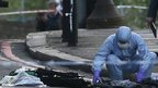 Officer gathers evidence at scene of Woolwich attack