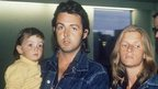 Paul McCartney holding his daughter Mary with wife Linda as he arrives at London airport on 25 March 1971