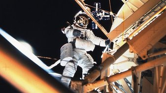 Astronaut performing a spacewalk on Skylab