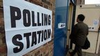 A man walks into a polling station
