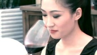 A Chinese woman drinking red wine