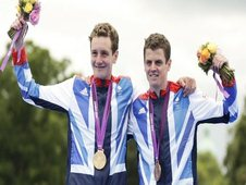 Alistair Brownlee (L) celebrates his gold medal with his brother Jonathan Brownlee who placed third after the men's triathlon final during the London 2012 Olympic Games at Hyde Park August 7, 2012. REUTERS/Tim Wimborne