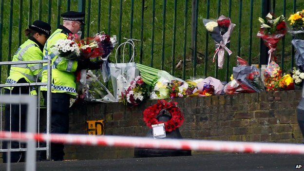 Police lay floral tributes