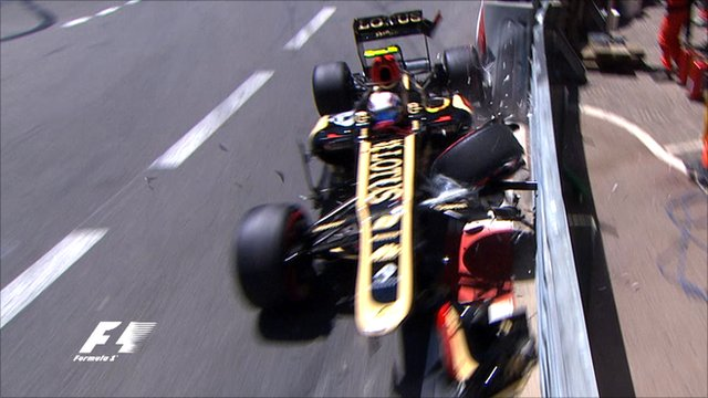 Romain Grosjean crashes his Lotus