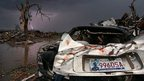Lightning from a thunderstorm strikes amid the wreckage of twisted cars and structures at Plaza Elementary School, where seven children were killed earlier in the week when a tornado hit Moore, Oklahoma, 23 May 2013