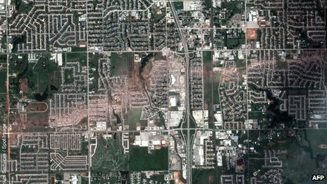 a satellite view of Moore, Oklahoma after the passage of a powerful tornado 23 May 2013