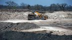 Bulldozer loads lorry in the Brazilian mining giant Vale's coalmine on the outskirts of Tete province, Mozambique, 8 November 2010